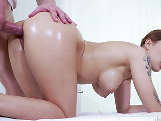 Masseur and his comely client take a crack at slippery sex on the enter