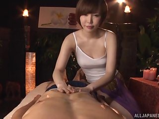 Short haired Japanese Satomi Yuria massages a cock with her pussy