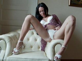 Katanna uses a black dildo to make her covetous cunt dripping wet
