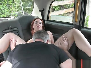 Redhead Euro slut gets banged by horny boots in the cab