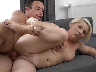 A granny in a fat ass is doing a blow job in a X manner
