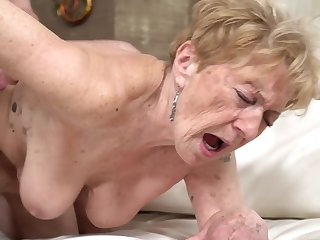 A nasty old granny is procurement fucked in her pussy doggy style