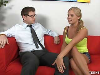 Shy blonde girl with big tits goes topless while giving a handjob