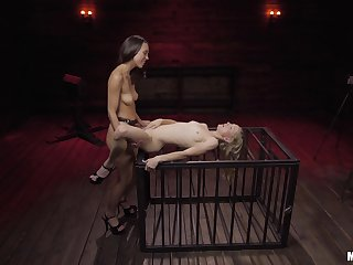 Nude lesbians share the strap-on connected with  their first femdom tryout