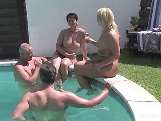 Mature amateurs fucked by the pool by their mature husbands