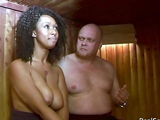 Ebony chick gets spanked in the sauna. Sallow guy spanking a black gal over the knee