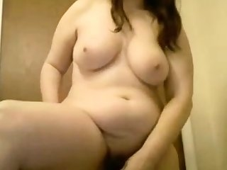 Sexy chubby chick cums with toy while standing