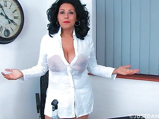 Naughty cougar Danica Collins decides to masturbate on the chair